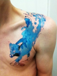 Blue fox tattoo on chest