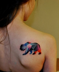 Geometric bear tattoo on shoulder blade