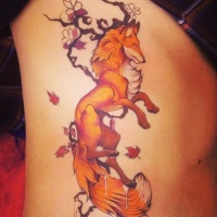 Red fox and tree branch tattoo